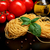 round balls of pasta with tomatoesbasilolive oil on black stock photo © dla4