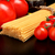 long pasta raw isolated on black with tomatoes and olive oil stock photo © dla4