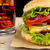 big cheeseburger with glass of cola on wooden table stock photo © dla4