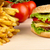 Cheeseburger,french fries with in the bar on wooden desk on black stock photo © dla4