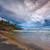 tempestade · praia · farol · pôr · do · sol · Índia - foto stock © dmitry_rukhlenko