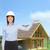 accueillant · souriant · femme · d'affaires · blanche · casque · bâtiment - photo stock © dolgachov