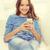 mosolyog · tinilány · okostelefon · otthon · technológia · internet - stock fotó © dolgachov