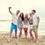 happy friends on beach and taking selfie stock photo © dolgachov