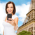 woman taking selfie with smartphone in paris stock photo © dolgachov