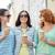 happy young women drinking coffee on city street stock photo © dolgachov