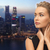 beautiful woman wearing earrings over evening city stock photo © dolgachov