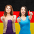 smiling girls showing thumbs up over german flag stock photo © dolgachov