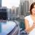 woman taking selfie by smartphone over dubai city stock photo © dolgachov