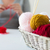 woman basket with knitting needles and yarn balls stock photo © dolgachov