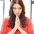 rezando · mujer · de · negocios · jóvenes · manos · pecho - foto stock © dolgachov
