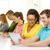 smiling students looking at tablet pc at school stock photo © dolgachov