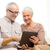 feliz · pareja · de · ancianos · ordenador · casa · usando · la · computadora · portátil · esposa - foto stock © dolgachov