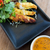 close up of deep fried asian snacks on plate stock photo © dolgachov