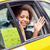 happy african woman calling on smartphone in taxi stock photo © dolgachov