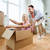 couple with cardboard boxes having fun at new home stock photo © dolgachov