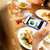 woman photographing food by smartphone stock photo © dolgachov