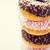 close up of glazed donuts pile over white stock photo © dolgachov