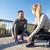 smiling couple tying shoelaces outdoors stock photo © dolgachov