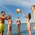 casal · praia · jogar · bola · prestados · alto - foto stock © dolgachov