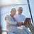 senior couple with tablet pc on sail boat or yacht stock photo © dolgachov