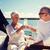 senior couple clinking glasses on boat or yacht stock photo © dolgachov
