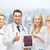 group of young doctors with tablet pc computer stock photo © dolgachov