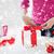 close up of woman decorating christmas presents stock photo © dolgachov