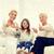 mosolyog · család · mutat · remek · otthon · boldogság - stock fotó © dolgachov