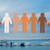 hands holding people pictogram over boats in sea stock photo © dolgachov
