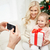 family taking picture with smartphone at christmas stock photo © dolgachov