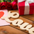 vörös · rózsák · valentin · nap · kártya · üdvözlőlap · fából · készült · felső - stock fotó © dolgachov