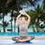 woman making yoga meditation in lotus pose on mat stock photo © dolgachov