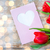 close up of tulips and greeting card with heart stock photo © dolgachov