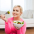 smiling young woman eating salad at home stock photo © dolgachov