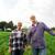 happy senior couple at summer farm stock photo © dolgachov