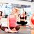 csoport · mosolyog · nők · nyújtás · tornaterem · fitnessz - stock fotó © dolgachov
