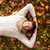 smiling young man lying on ground in autumn park stock photo © dolgachov