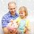 boldog · apa · lánygyermek · nagy · persely · család - stock fotó © dolgachov