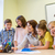 colegialas · sonriendo · mesa · sesión · casa - foto stock © dolgachov