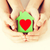 couple hands holding green paper house stock photo © dolgachov