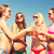 gruppo · sorridere · giovani · donne · bere · spiaggia - foto d'archivio © dolgachov