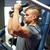man exercising and flexing muscles on gym machine stock photo © dolgachov