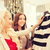 happy young women choosing clothes in mall stock photo © dolgachov