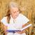 mosolyog · fiatal · nő · olvas · könyv · gabonapehely · mező - stock fotó © dolgachov