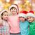 happy little children in santa hats hugging stock photo © dolgachov