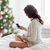 pregnant woman with smartphone in bed at christmas stock photo © dolgachov