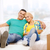 smiling couple relaxing on sofa in new home stock photo © dolgachov