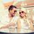 smiling couple in sunglasses drinking wine in cafe stock photo © dolgachov