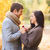 close up of smiling couple with gift box in park stock photo © dolgachov